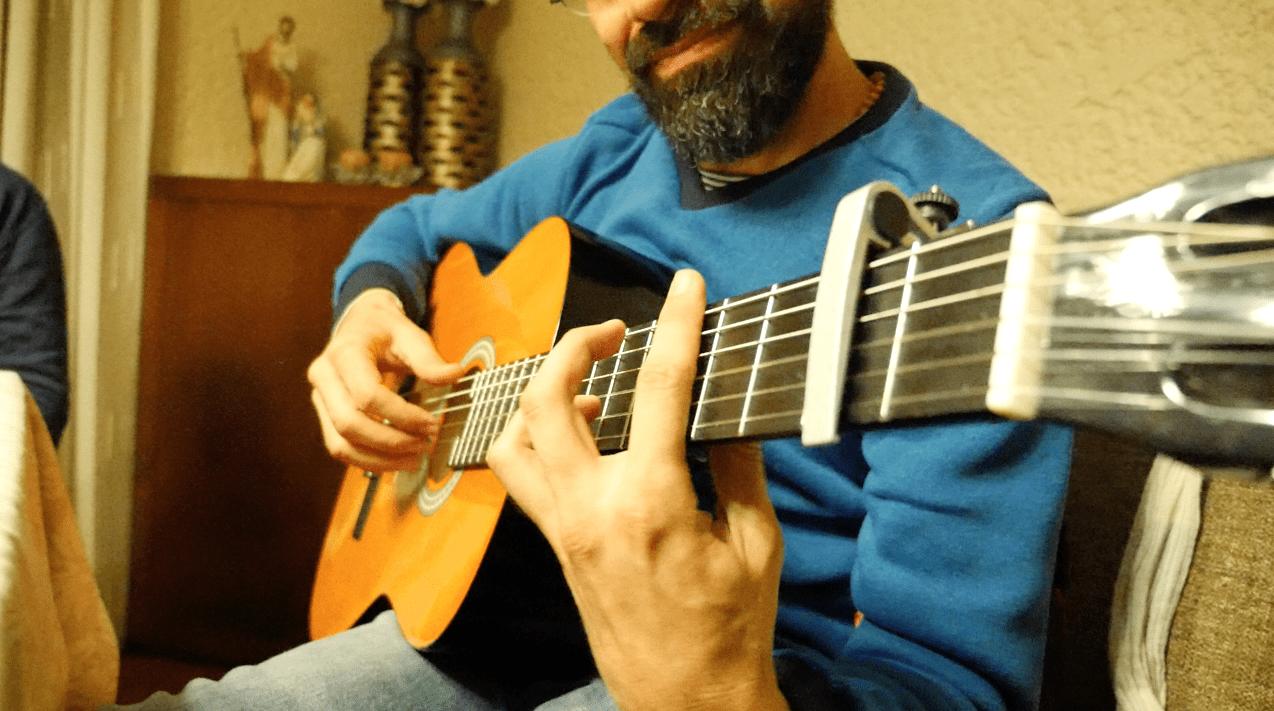 ernesto playing guitar
